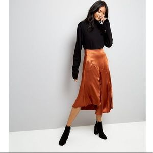 Calf-length, asymmetric-cut skirt in satin
